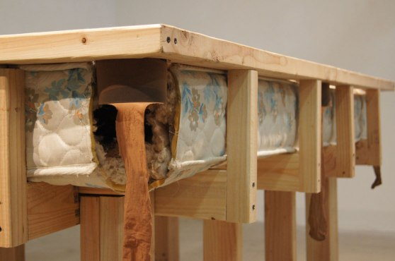 detail: side view of one nylon-lined rubber corner pocket